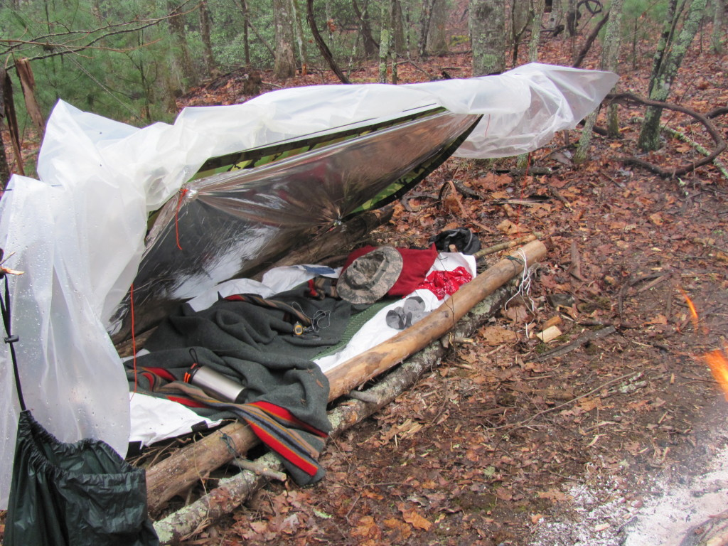 Supershelter on wood frame bed with Army Poncho.