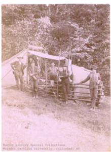 Kephart's first classroom in the Smokies.  The fence was to keep wild hogs out.  The smaller canvas structure to the right was his pantry. (Photo: Hunter Library, Western Carolina University, Collowhee, NC)