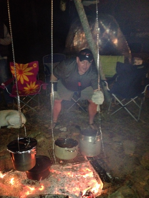 """Yours truly working hard cooking for a dozen adults .  The structure was especially great as it kept a cooking area as a """"cooking area"""" as there were over a dozen kids running around.  Yes, that is a moveable SuperShelter in the background.  Kids though it was cool!"""