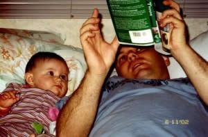 Start'em young.  Note the book.