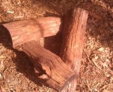 """Vortex"" fire lay with chestnut logs."