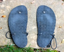 Bottom soles of a pair of my huaraches.  Note the wear towards the front and not the heel.  I have always walked in these, not run.