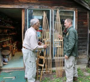 """Mors showing Joe Flowers the Roycraft Ski Shoe outside """"The Book Factory."""""""