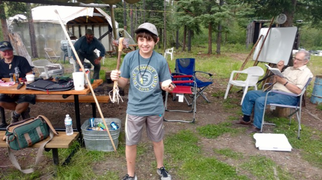 Luckiest kid ever, an obsidian blade axe wrapped in buckskin and buffalo hoof rattle gifted to him by Randy and Lori.