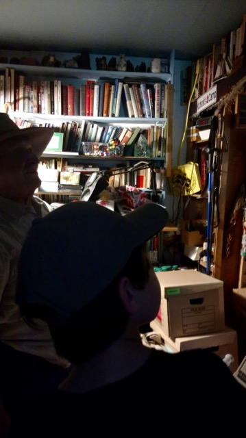 Duncan with Mors in his one room full of books dedicated to just Bushcraft.