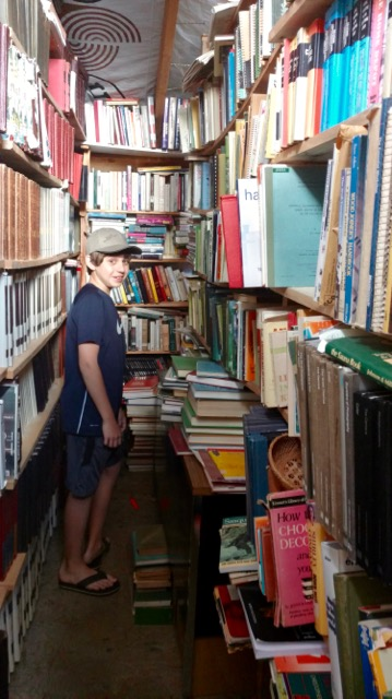 Duncan exploring one part of Mors' library.