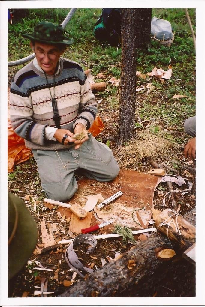 Mors preparing to teach a fire-by-friction class. He uses material from the forest around him and his knowledge of the science behind the process to teach it in a more expedient manner.